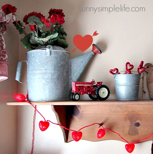 galvanized watering can, heart lights, old toy tractor