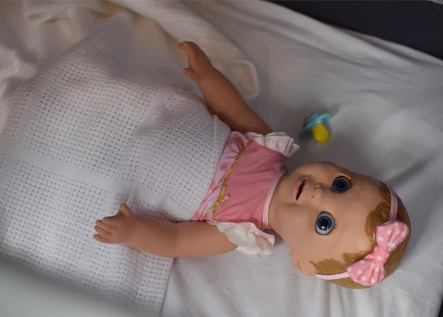 Luvabella Doll in crib