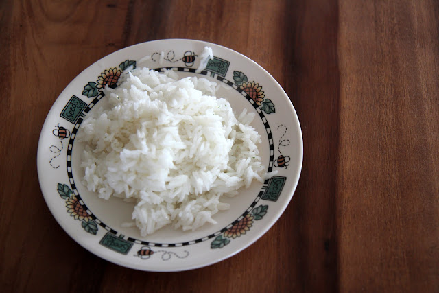 Make rice in the oven and avoid sticky or under cooked messes! This easiest ever garlic rice recipe is a family favorite.