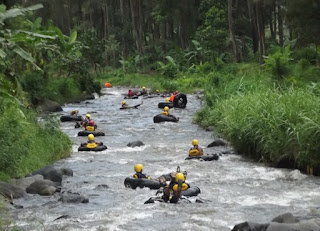 Tubing in Sungai Batang Tangkahan In North Sumatra