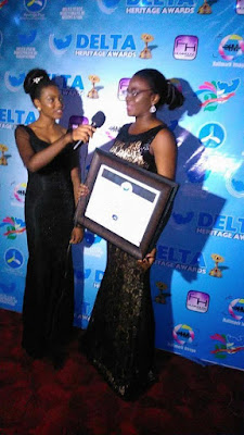 Michelle Ekure, UNIBEN female graduate cum shoemaker, receives Delta Heritage award