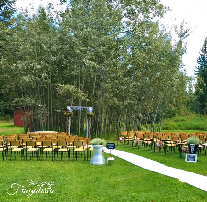 Adorable DIY Bride and Groom Flower Pots flanking the aisle of an outdoor wedding.