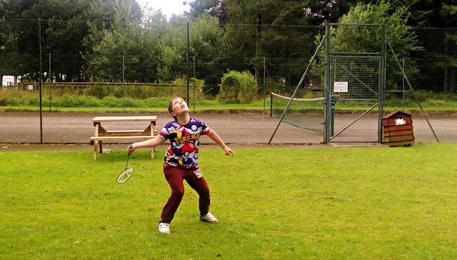 Boy playing badminton at Forest Glade
