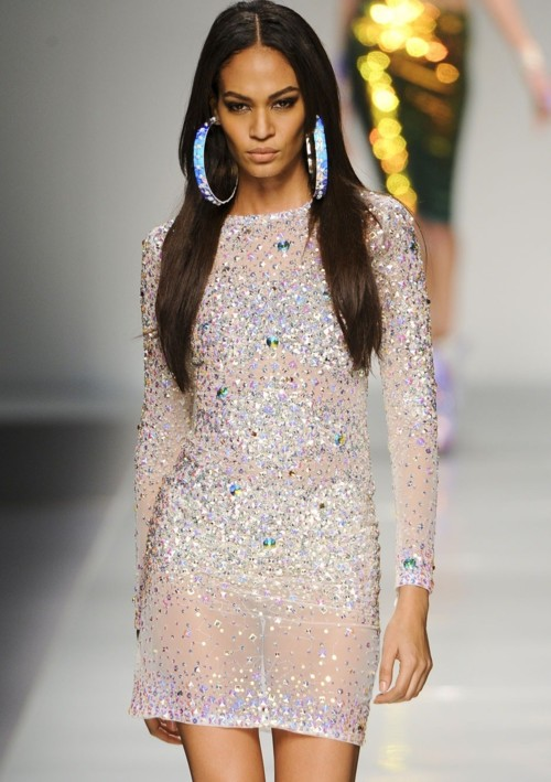 Puerto Rican model Joan Smalls presents a creation by