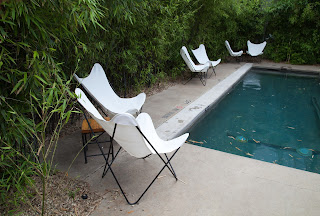 Fine art image of lawn chairs next to a swimming pool, taken in Austin, Texas on South Congress Avenue