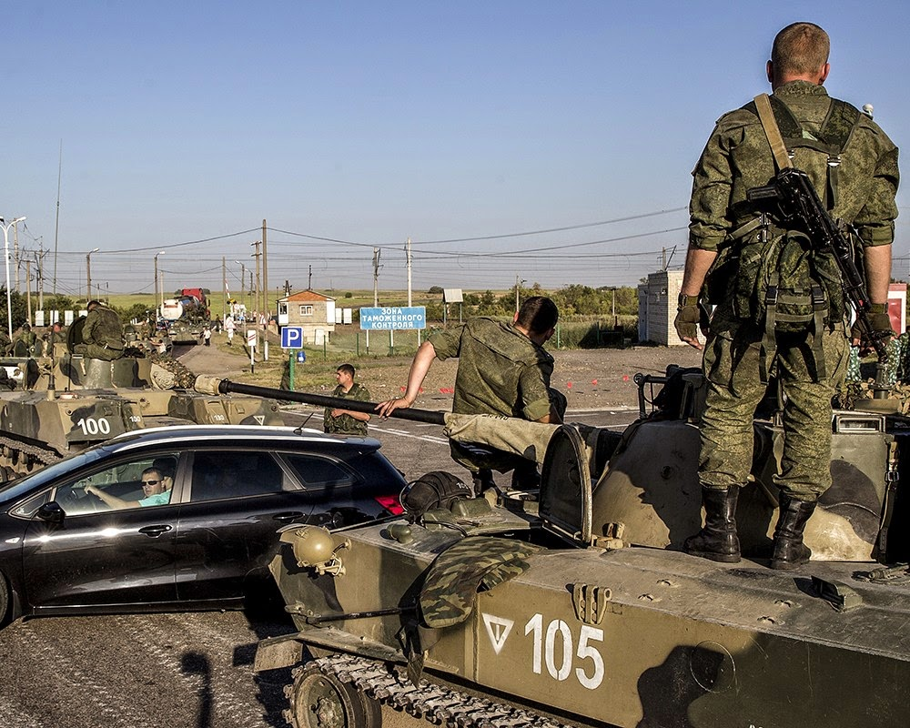 International journalists evidenced Russian APCs cross ing Ukrainian border.
