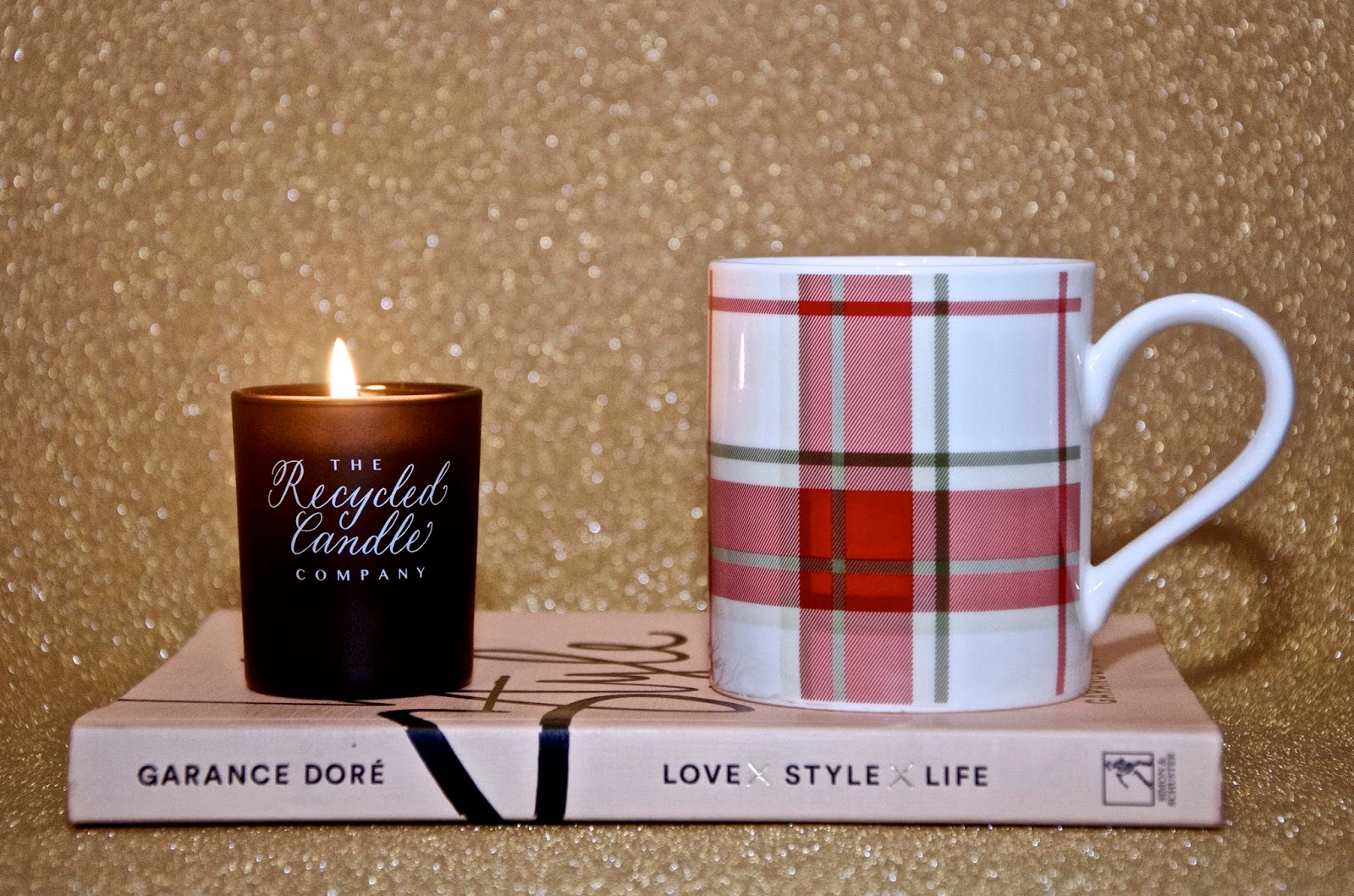 Recycled Candle Company votive candle, plaid coffee mug and Garance Dore Book