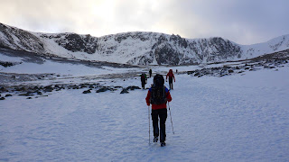 Adam walking into Coire an t-Sneachda on a Cairngorm winter mountaineering course