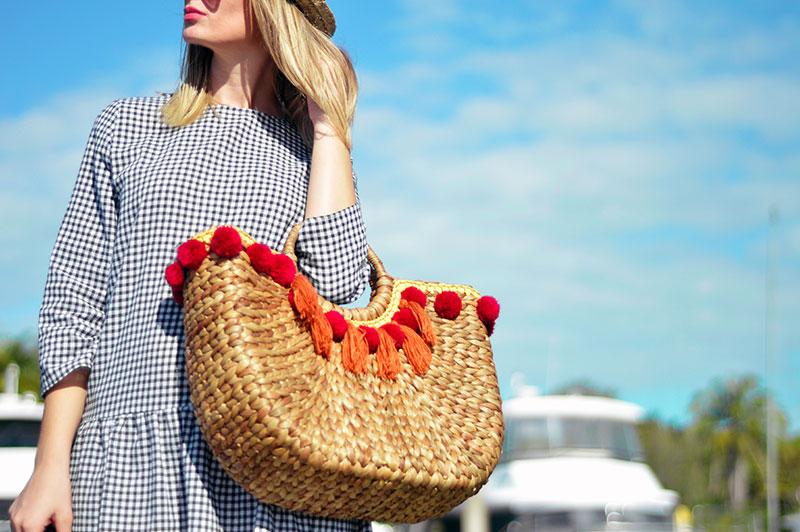wicker straw basket bag with pom pom summer 2017 bag trend