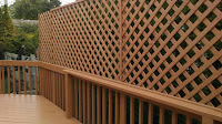 Back Deck lattice. Stained and replaced railing.
