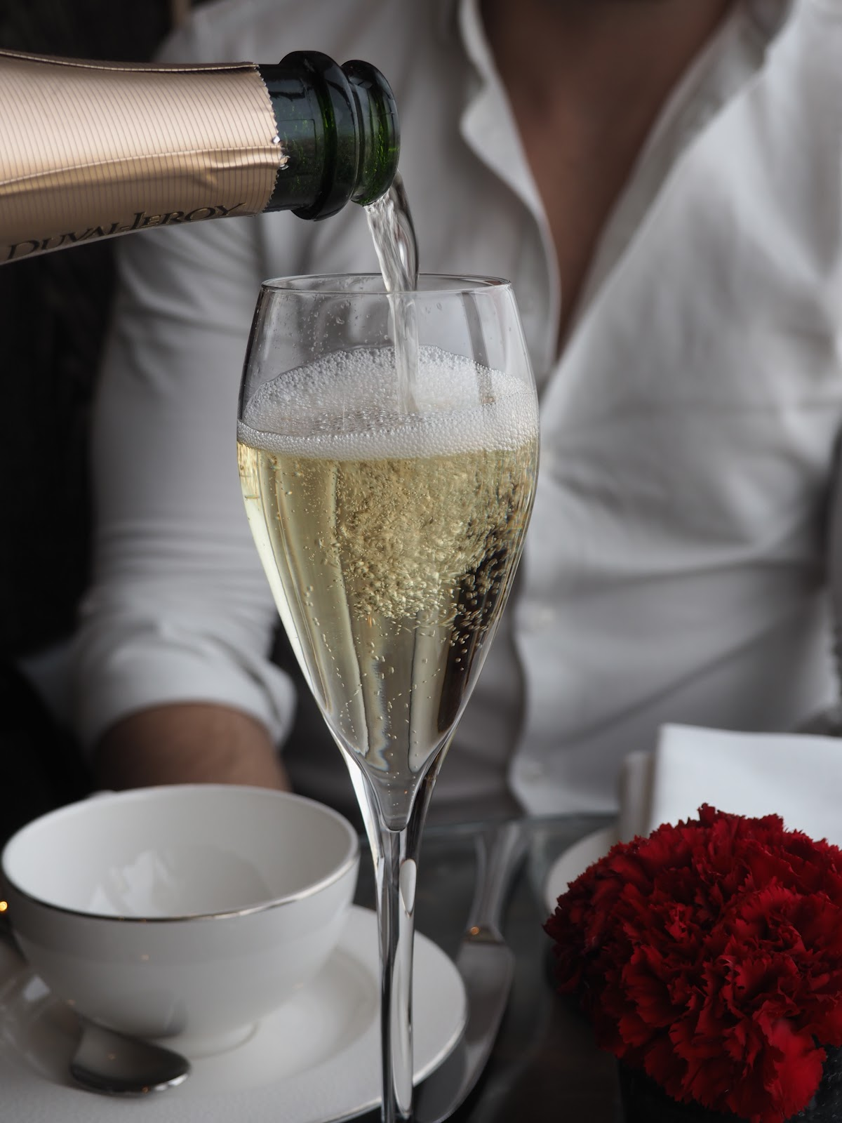 Champagne being poured at Afternoon Tea at GONG Bar at the Shangri La at The Shard