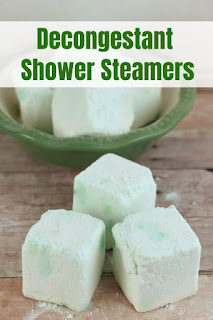 These shower fizzies diy are for when you have a cold, cough, or congestion.  How to make shower soothers with eucalyptus essential oil and other essential oils for natural relief.  This home remedy uses shower steamers to turn your shower into an aromatherapy spa.  Get natural relief from your cold or cough with these diy shower melts made with natural essential oils.  #showermelt #showersteamer #essentialoil #showerfizzy #diy #diybathbody #homeremedy #cough #cold