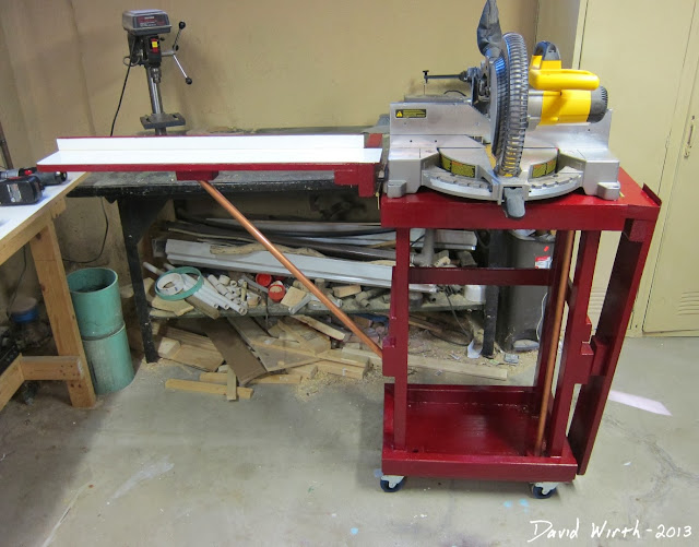 wood miter saw stand, folding arms, on wheels, woodshop