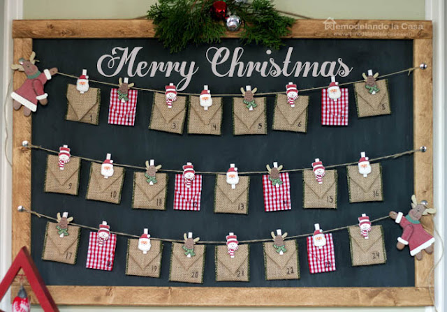 Jute rope clothespins garland holding envelopes on chalkboard