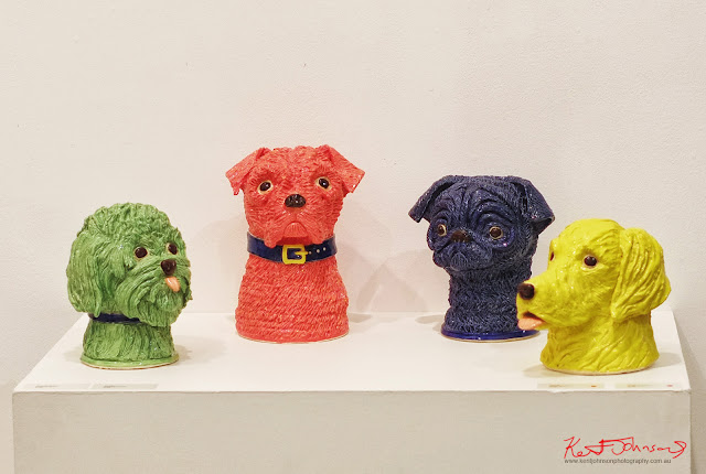 Ceramic Dogs heads by Caroline Gibbes - Photography by Kent Johnson.