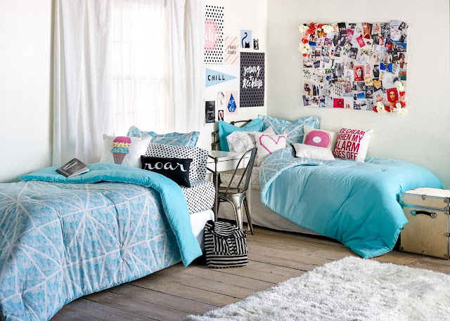 cute dorm room ideas with blue single beds on wood floor and white fur rug