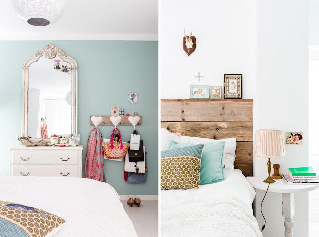 dormitorio con cómoda antigua y cabezal de madera natural