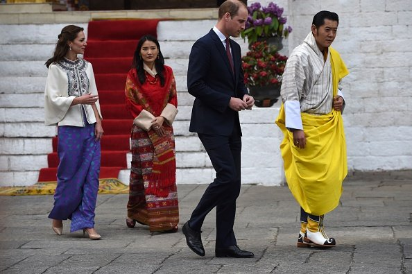 Prince William and Kate Middleton walk with King Jigme Khesar Namgyel Wangchuck and Queen Jetsun Pema from a Buddhist Temple inside the Tashichodzong in Thimphu.