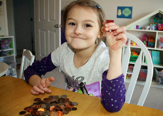 Tessa identified various coins and their worth. She compared and contrasted the coins as well.