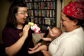 Image: Cpl. Gretch Sweeney and Elaine Sexton play with baby Emily- FMWRC - US Army - 100813, by U.S. Army on Flickr