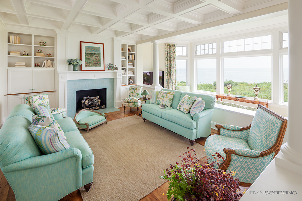 Teal accents fill the living room at an elegant oceanview home built by Bowley Builders.