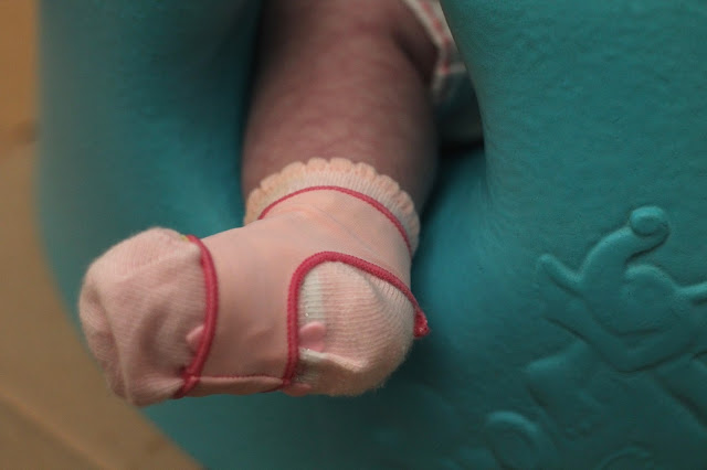 pink sock on on baby