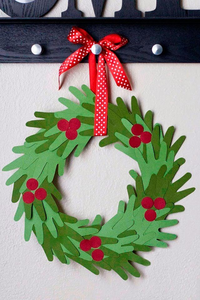 Make this adorable and super easy hand print Christmas Wreath with you kids! | My Name Is Snickerdoodle