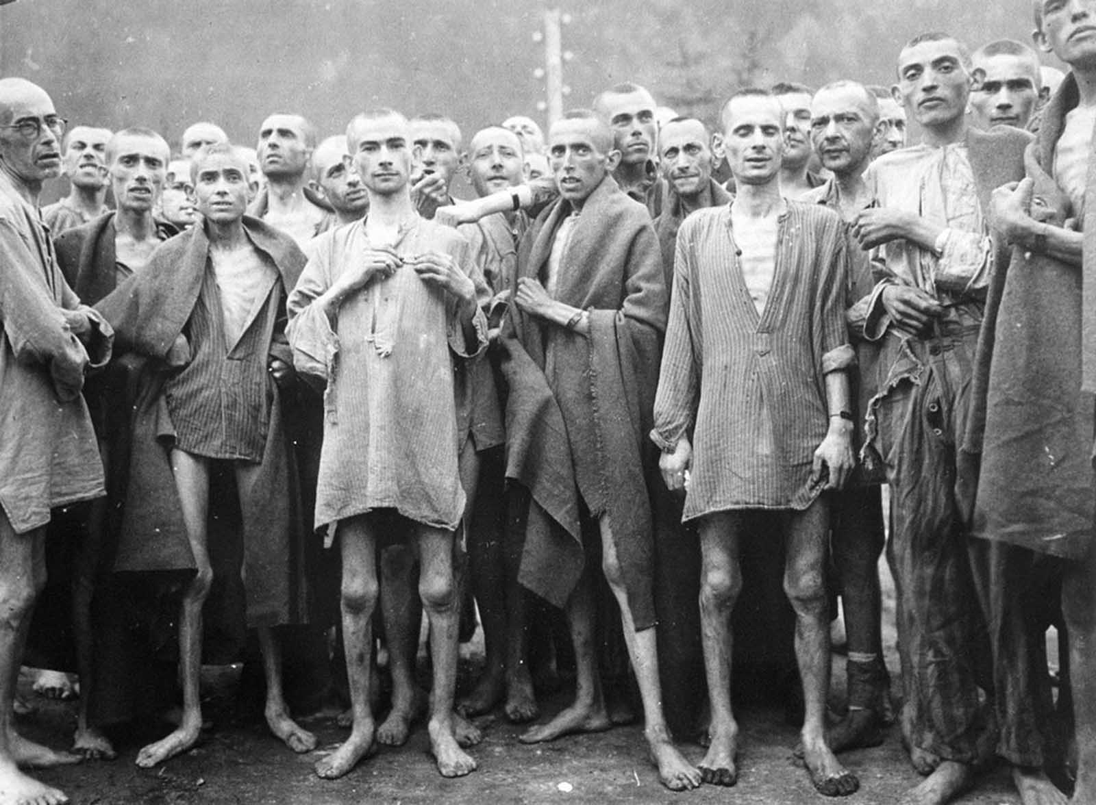 Starved prisoners, nearly dead from hunger, pose in a concentration camp in Ebensee, Austria, on May 7, 1945. The camp was reputedly used for