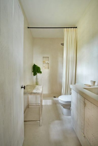 Gorgeous and calm monochromatic bathroom with minimal natural decor - found on Hello Lovely Studio