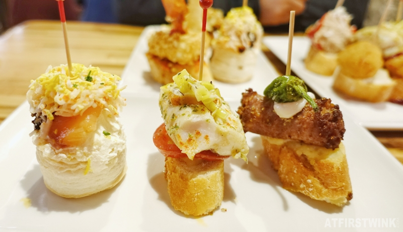 Pinchos and drinks in Barcelona Spain baguette toppings fish sausage