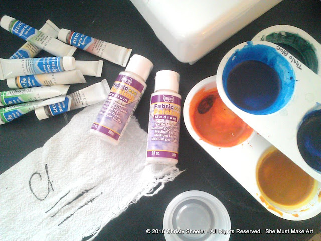 Gathering supplies for the practice run with watercolors on fabric.