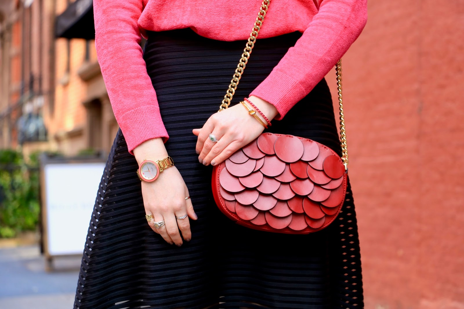 Nyc fashion blogger Kathleen Harper carrying a red Michael Kors purse