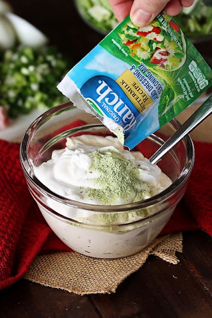 Making Creamy Ranch Dressing in a Small Bowl with Dry Ranch Dressing Mix Image