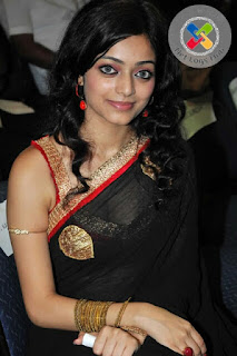 South Indian Actress Janani Iyer Long hair Hot Hip Navel Stills In Transparent Black Saree - NetLogsHub