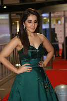 Raashi Khanna in Dark Green Sleeveless Strapless Deep neck Gown at 64th Jio Filmfare Awards South ~  Exclusive 115.JPG