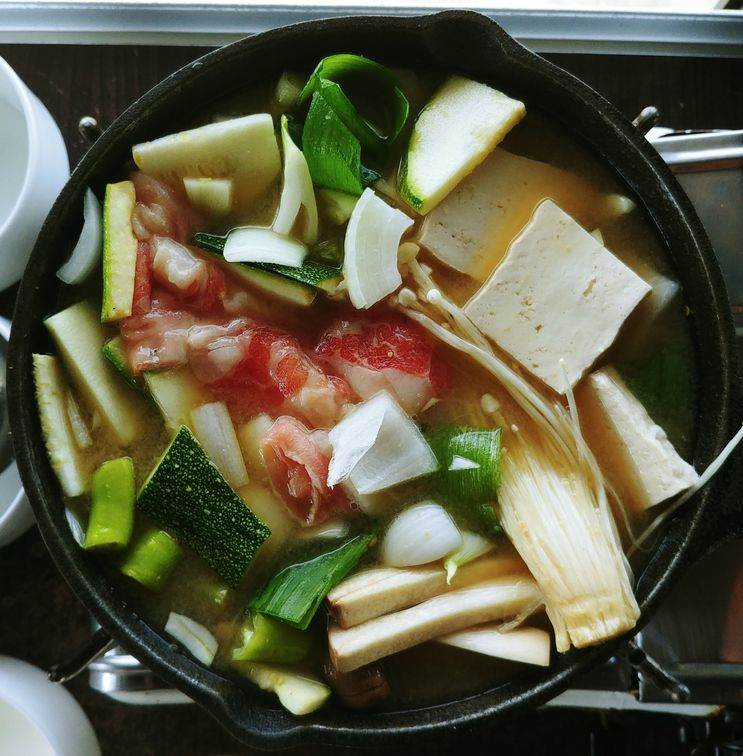 hotpot soup of meat, vegetables, and mushrooms at nice two Meat u