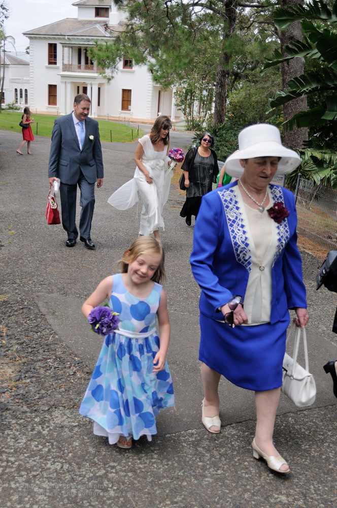 Walking through the garden at Strickland House after the wedding ceremony, Garden Wedding Photographer Sydney.