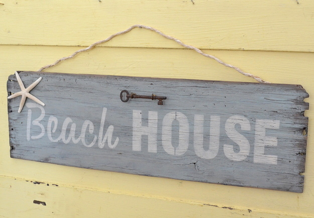 Make a hanging Beach House sign with the side of an old crate