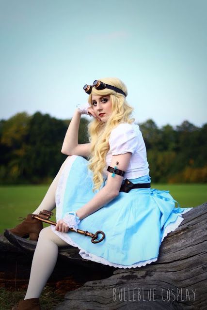 Women's steampunk alice in wonderland cosplay. costume consists of white blouse, blue skirt, goggles, magic potions, giant key and ankle booties
