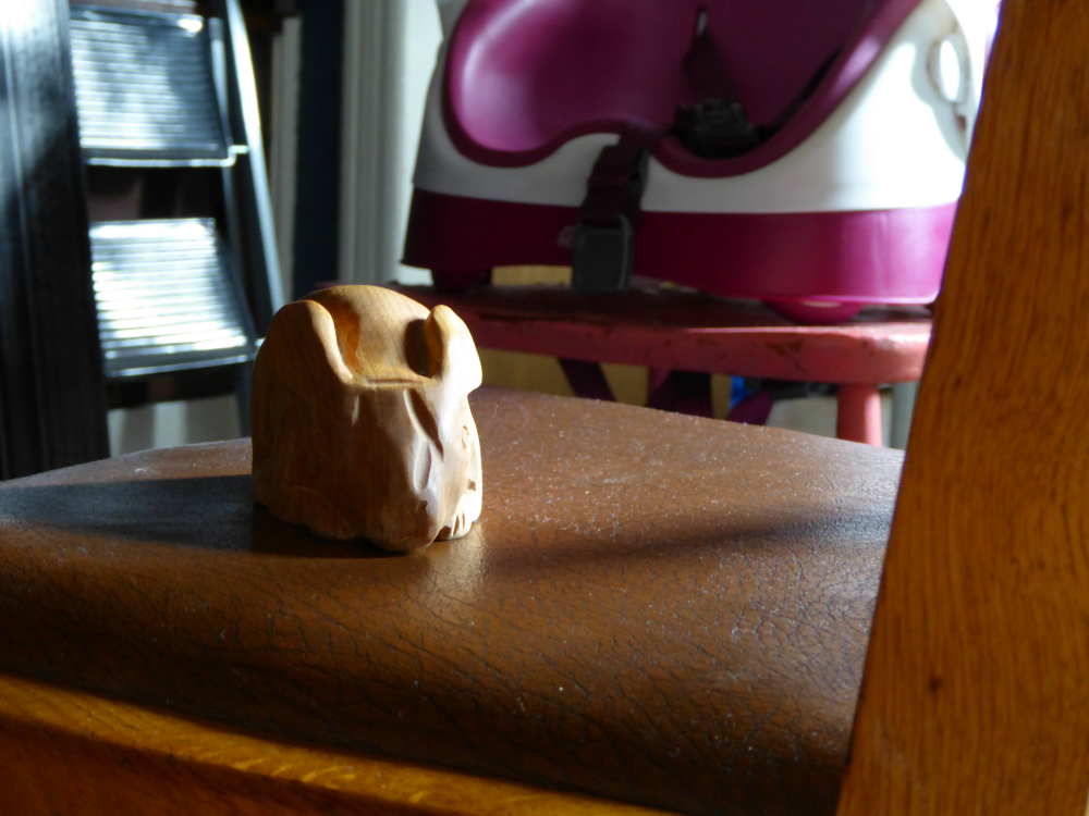 Wooden rabbit toy on a chair
