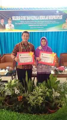 Dua Guru SMPN 1 Model Babat Toman Raih Penghargaan