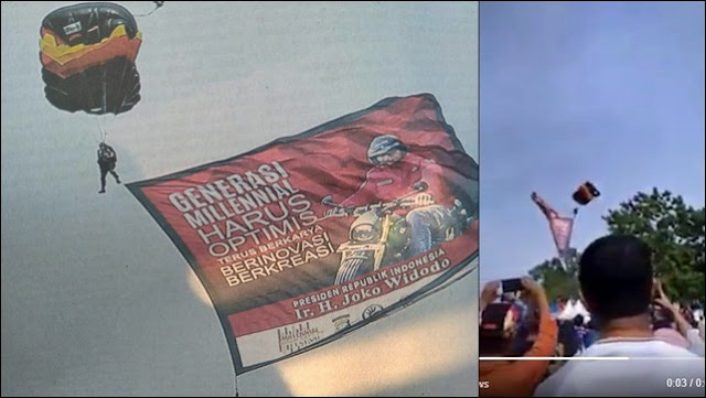 Penerjun Payung yang Kibarkan Bendera Jokowi Nyangkut di Pohon