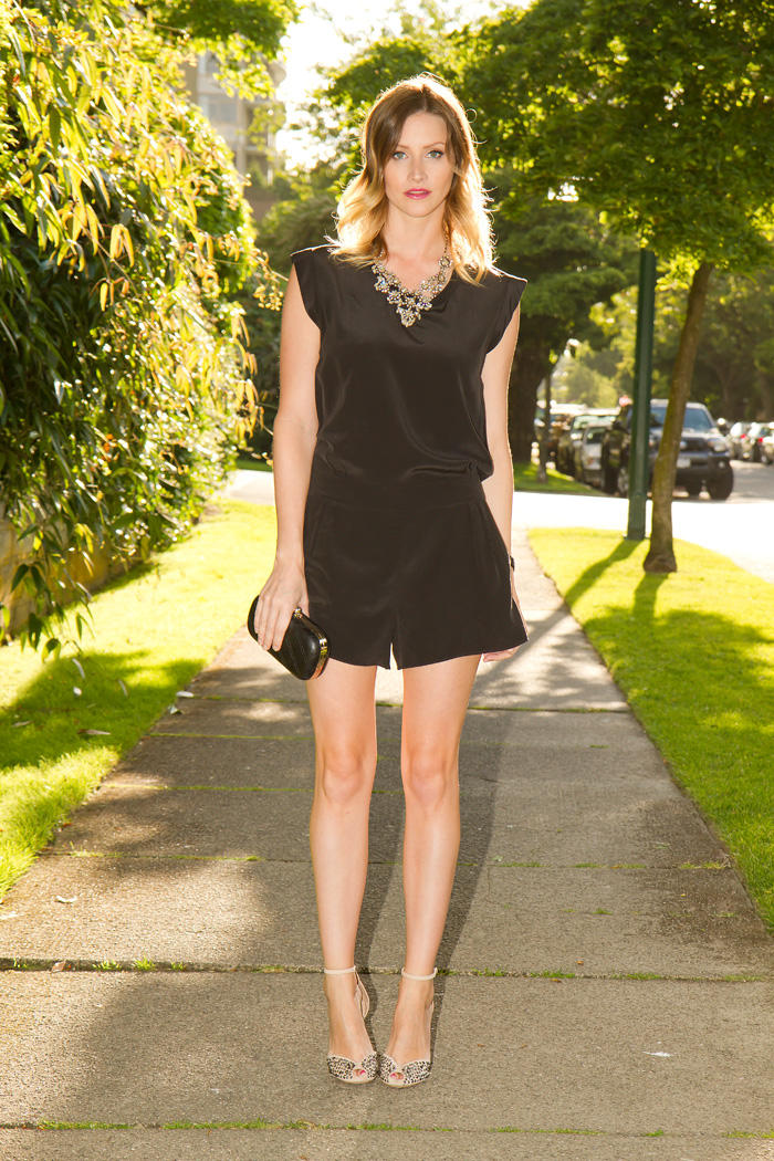 Vancouver Fashion Blogger, Alison Hutchinson of Fashion Blog Styling My Life, is wearing a black silk romper playsuit from Aritzia, J.Crew crystal statement necklace, Zara nude suede ankle strap sandals, collete black quilted clutch