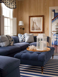 wonderful living room with navy sofa and ottoman on navy white striped rug plus coral and lantern nautical decorating ideas