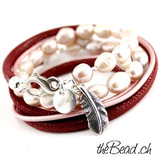 Perlenschmuck mit Silberfeder