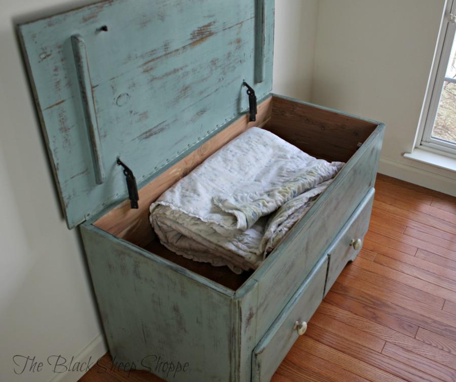 Quilt inside blanket chest.