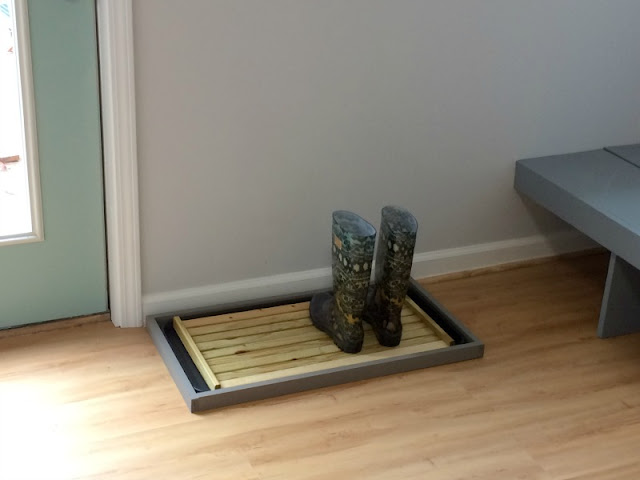 We used a large plastic tray and scrap wood to make a drying tray for our shoes and boots.