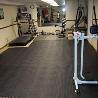 Greatmats staylock bump top tiles in home gym weight room on top of carpet