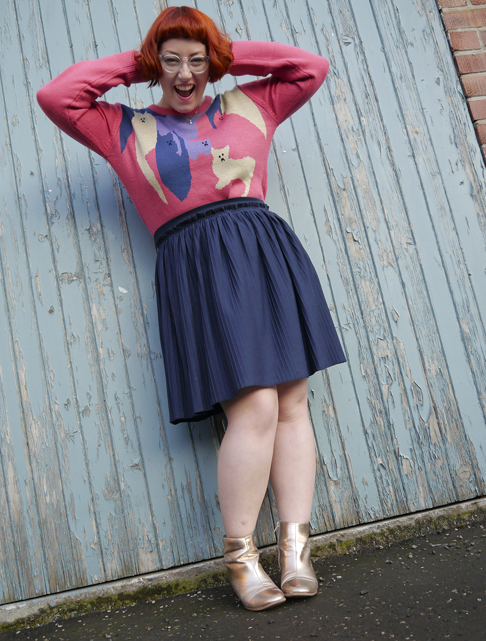 Styled by Helen, Scottish blogger, Dundee blogger, Scottish fashion blogger, quirky style, Scottish street style, cute style, cat clothing, dressing to a theme, cat themed clothing, cat jumper, colourful outfit, colourful street style, La La Land, colourful cat jumper, pink jumper, pink and blue outfit, red head, ginger bob, clear glasses, Iolla glasses, cat necklace, silver cat necklace, gold boots, cat pose, cute cat outfit