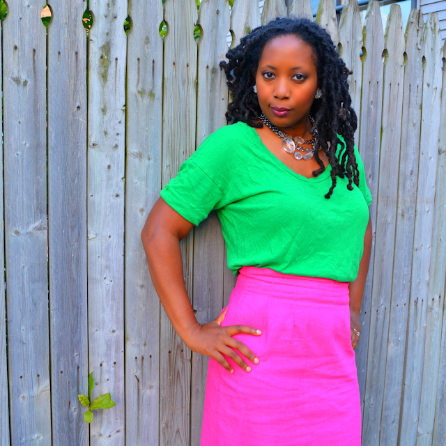 green tee worn with pink pencil skirt